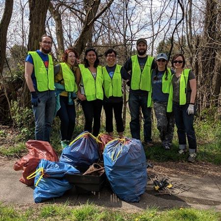 JB Media team volunteering with Asheville Greenworks
